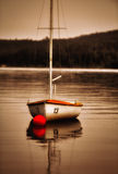 Sailboat at sunset. Number thirteen sailboat at sunset on Grand Lake in Maine Stock Photos