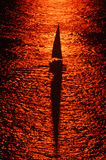 Sailboat at Sunset. Aerial view of silhouetted sailboat at sunset Royalty Free Stock Photo
