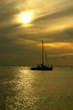 Sailboat Sunset. Ocean sunset with sailboat Royalty Free Stock Photo