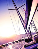 Sailboat on sunset Stock Images