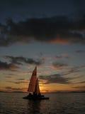 Sailboat at sunset royalty free stock photo