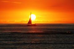 Sailboat at sunset. Sunset at Wakiki Beach in Honolulu, Hawaii Stock Images