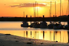 Sailboat sunset. Sailboat silhouette at sunset Stock Image