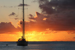 Sailboat during sunset above the sea Royalty Free Stock Image