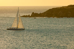 Sailboat at Sunset on the Caribbean Sea Stock Images