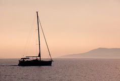Sailboat on sunset Stock Photography