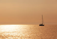 Sailboat on sunset Royalty Free Stock Photography