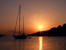 Sailboat at sunset Ibiza coast Stock Photos