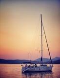Sailboat in sunset light Stock Photo