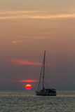 Sailboat on sunset. Sunset in Nai Harn beach and sailboat silhouette. Phuket, Thailand Royalty Free Stock Photos