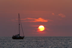 Sailboat and sunset. Sunset in Nai Harn beach and sailboat silhouette. Phuket, Thailand Stock Images