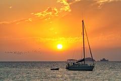 Sailboat in sunset off Ibiza coast Royalty Free Stock Images