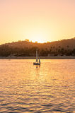 The sailboat at sunset Stock Photography