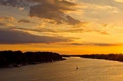 Sailboat at sunset on Sava river Royalty Free Stock Photography