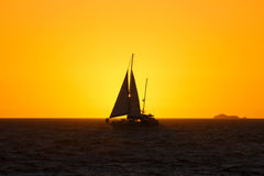 Sailboat at sunset. A silhouetted sailboat and open sea at sunset, Fremantle, Australia Stock Images