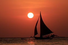 Sailboat at sunset Stock Images