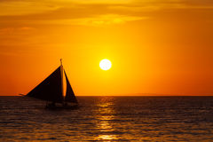 Sailboat at sunset on a tropical sea. Silhouette photo. Royalty Free Stock Photos