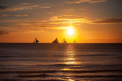 Sailboat at sunset on a tropical sea Stock Photography