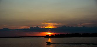 Sailboat at sunset of the Volga River. Red sunset on the river stock photography