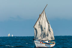 Sailboat torn sails peruvian coast Piura Peru. Sailboat with torn sails in the peruvian coast at Piura Peru stock photo