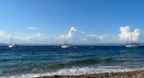 Sailboat Trio. Tree sailboats at anchor off coast of Porquerolles island, France Stock Image