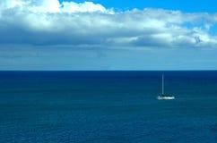Sailboat in tropical ocean waters Stock Image