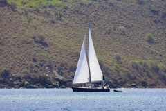 Sailboat in the tropics. Large luxurious boat sailing through the tropics Royalty Free Stock Photos