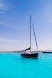 Sailboat in turquoise beach of Formentera Royalty Free Stock Image