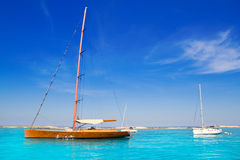 Sailboat in turquoise beach of Formentera Royalty Free Stock Photos