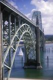 A sailboat under an arched bridge over Yaquina Bay at Newport, Oregon Royalty Free Stock Photography