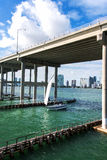 Sailboat under a Highway Royalty Free Stock Image