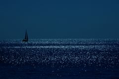 Sailboat under the moon. Stock Photography