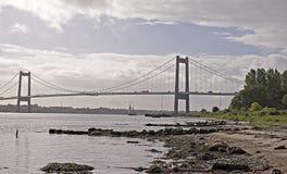 Sailboat under suspension bridge Royalty Free Stock Photography