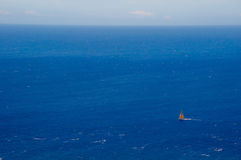 Sailboat on the vast ocean Stock Photo