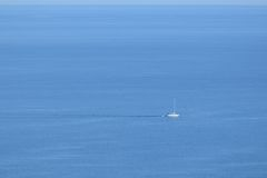 Sailboat on Vast Open Ocean Royalty Free Stock Photo