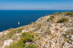 Sailboat and views of Javea sea from San Antonio Cape Royalty Free Stock Images