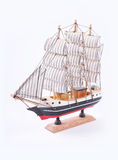 A sailboat vintage model on white background. Toy model sailboat on white background slant version stock photo