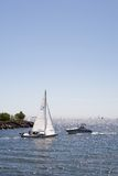 Sailboat vs. Motorboat. Sailboat and motorboat very close of each other Royalty Free Stock Photography
