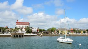 Sailboat and waterfront buildings Stock Photo