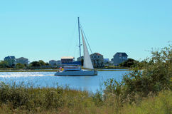 Sailboat in the Waterway. Sailboat sailing down the waterway of east coast North Carolina Royalty Free Stock Images