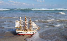 Sailboat on wave Royalty Free Stock Images