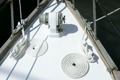 Sailboat white bow with bollard and spiral rope Stock Photo