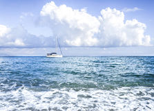 Sailboat. Wihh cloudy blue sky Stock Images