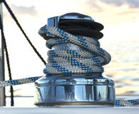 Sailboat winch. A sailboat winch and a blue ocean Stock Photography
