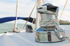 Sailboat Winch and Rope closeup Catamaran Yacht detail. Yachting Stock Photo