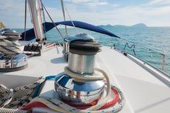 Sailboat Winch and Rope closeup Catamaran Yacht detail. Yachting Stock Image