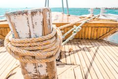 Sailboat winch and rope yacht detail. Yacht winch royalty free stock photo