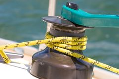 Sailboat winche. Yellow rope in a winche of a sailboat stock image
