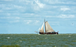 Sailboat in the wind, Holland Stock Images