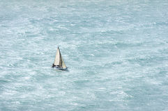 Sailboat with wind and rough sea Royalty Free Stock Photos